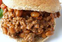 Close up of a sloppy joe sandwich on a whole wheat bun