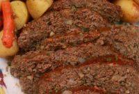 A platter of sliced meatloaf and steamed vegetables from the instant pot.